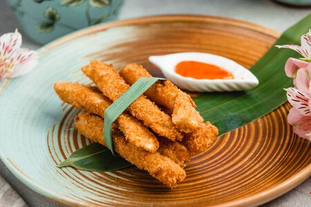 crispy chicken nuggets with spicy sauce