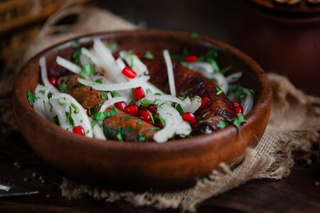 Fried sausage with onion and pomegranate Banco de Imagens
