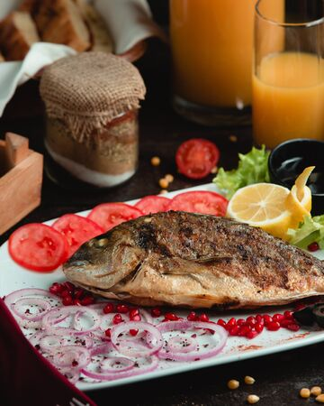 Baked fish with onion pomegranate and tomato Stok Fotoğraf