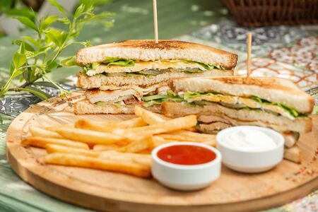 Classic chicken club sendwich with french fries