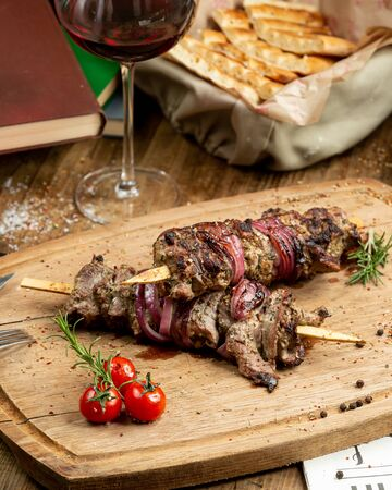 Traditional kebab on the wooden board