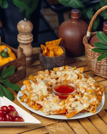 Nachos with cheese and sauce Фото со стока