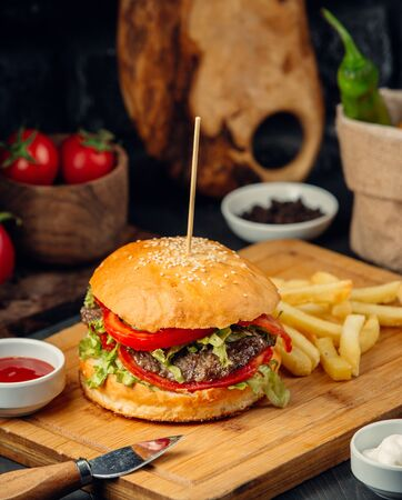 Beef burger with french fries and ketchup