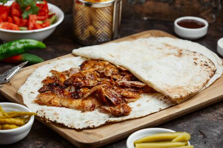 Chicken kebab slices served in the lavash wrap