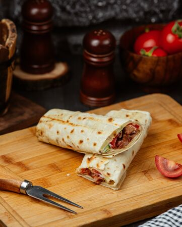 Chicken wrap with tomato, cucumber and mayonnaise