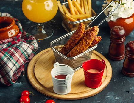 Chicken croquettes served with french fries, mayo and ketchup
