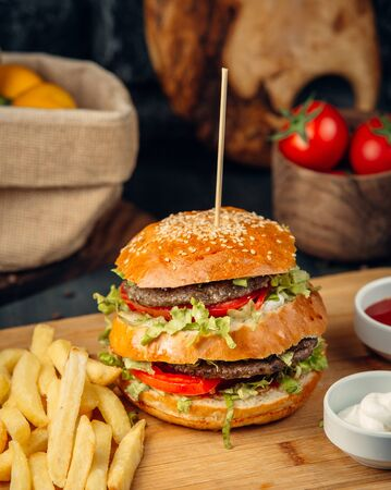 Double beef burger served with french fries