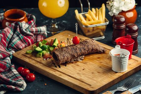 Steak roll served with cucumber, tomato, dill and olive oil salad