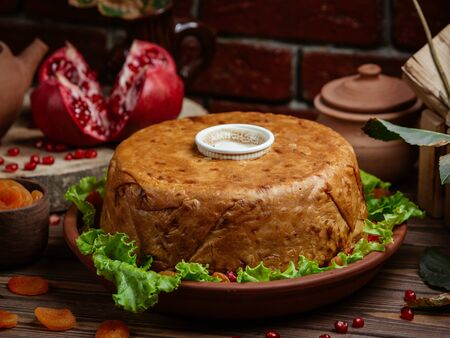Shah pilaf rice in lavash crust decorated with pomegranate Stok Fotoğraf - 130620514