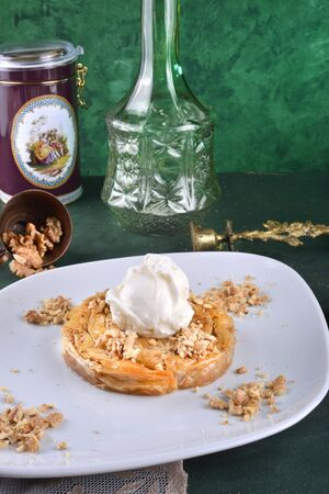 Traditional turkish dessert with walnut and icecream on top