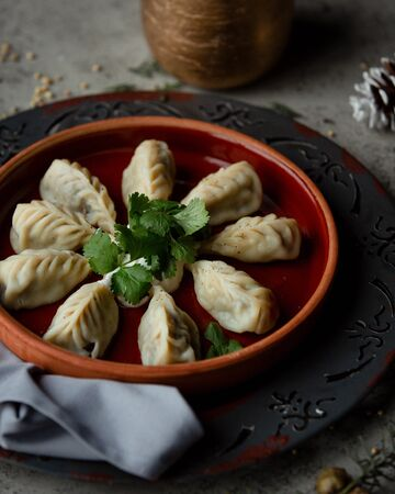 Gurza azerbaijani dumplings served with yoghurt in pottery ban
