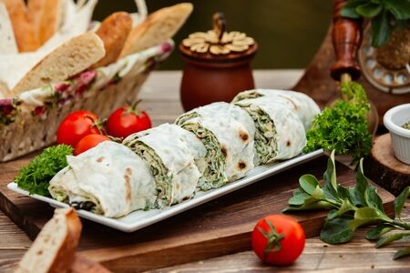 Turkish bourak layers of flatbreads wrapped with fresh herbs and cheese