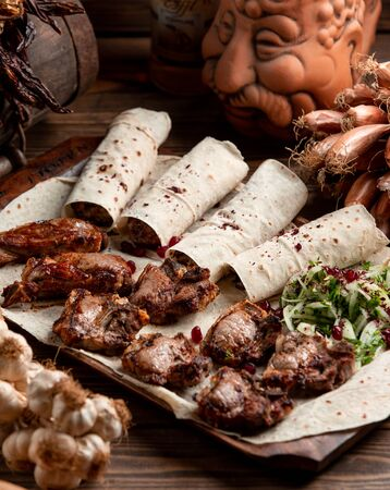 Lula kebab and tikka kebab served with lavash bread