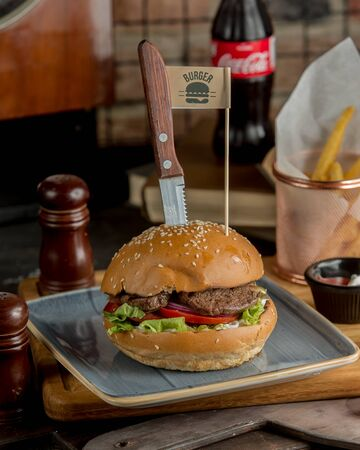 Beef burger served with french fries Stockfoto