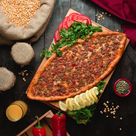 Spicy pide with meat and red pepper
