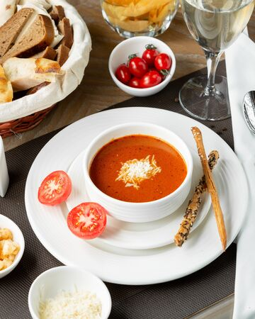 Tomato soup with cheese chips