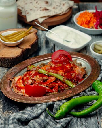 Roasted meat slices with green pepper and topped with ketchup