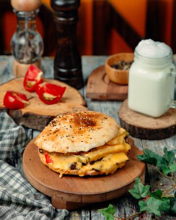 Ð¡heeseburger with lots of melted cheese