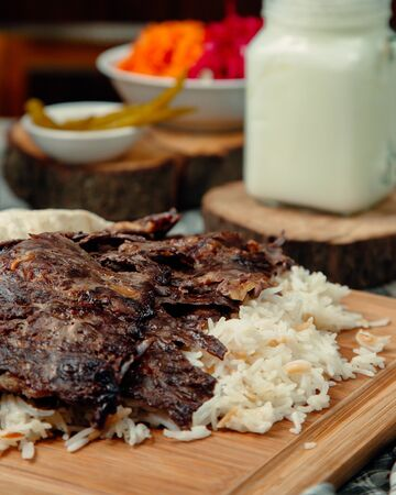 Overroasted meat slices with rice