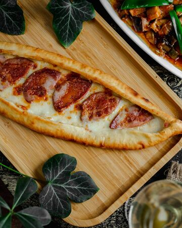 Pide with sausage and melted cheese