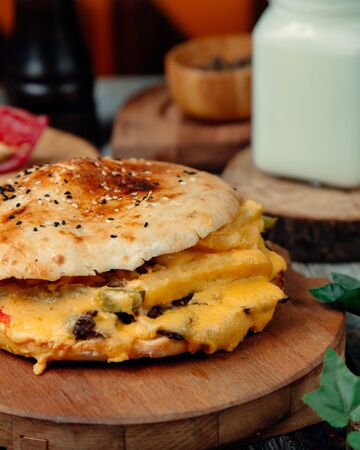 Cheeseburger with lots of melted cheese