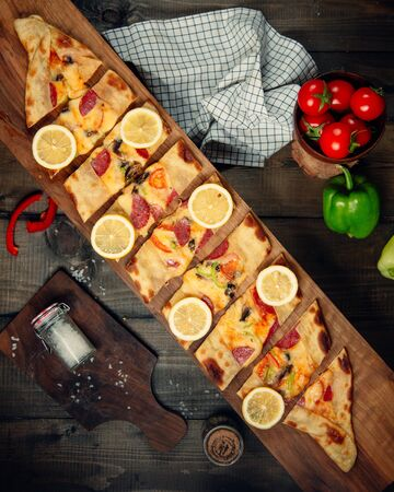 Sliced pide topped with lemon