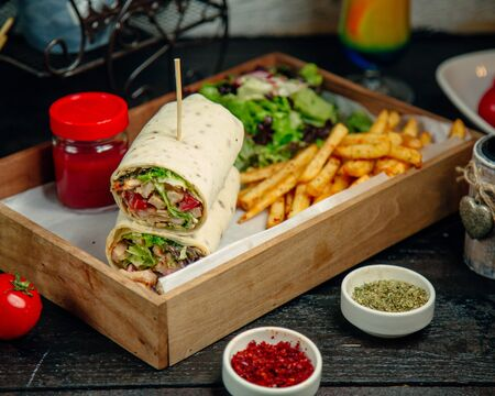 Chicken wrap served with fries and salad