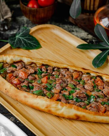 Pide with meat and green pepper