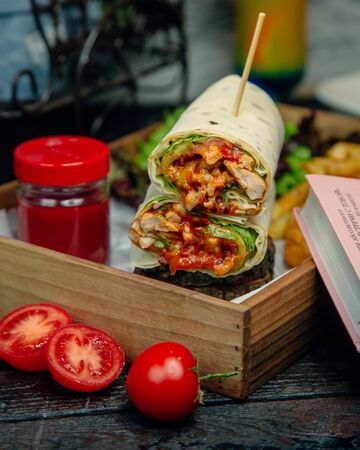 Chicken wrap served with ketchup