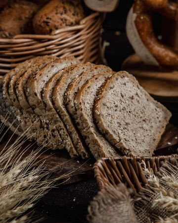 Sliced gray bread coated with grains
