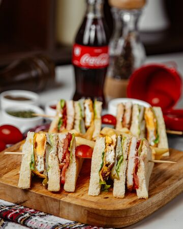 Club sandwich slices with cola Stockfoto
