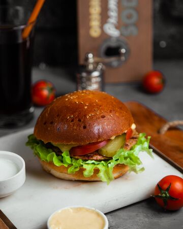 burger with cutlet, cabbage and acid cucumber Banque d'images - 132306362
