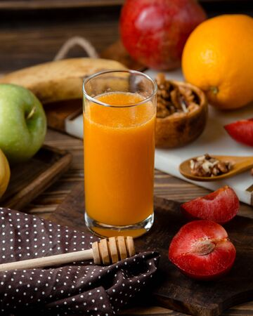 glass of fresh juice with assortment fruits