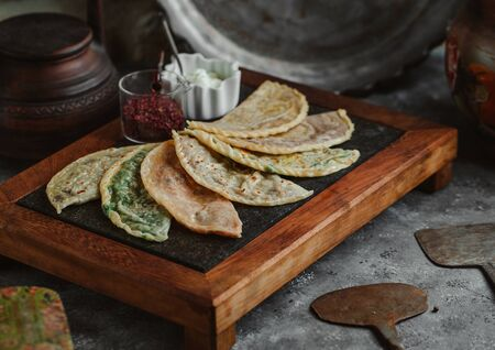 gutab stuffed flatbreads board served with sumac and yoghurt