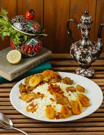 a plate of azerbaijani pilaf with roasted dried fruits, and gazmag