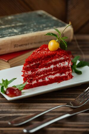 close up of red velvet cake in white small platter