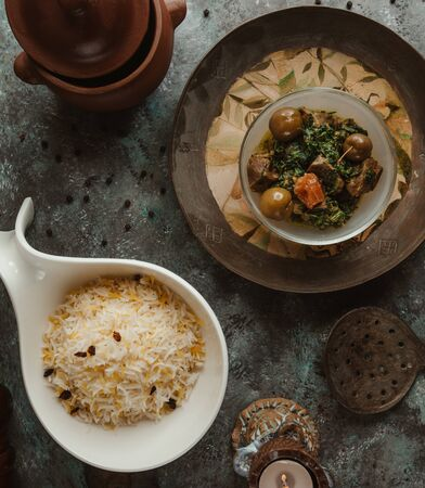 top view of pilaf rice with meat with herbs in vintage plate