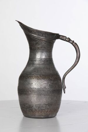 traditional azerbaijani antique pitcher with ornaments in white background Banco de Imagens