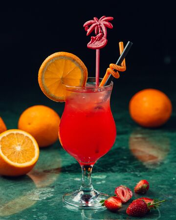 fruit cocktail with orange on the table