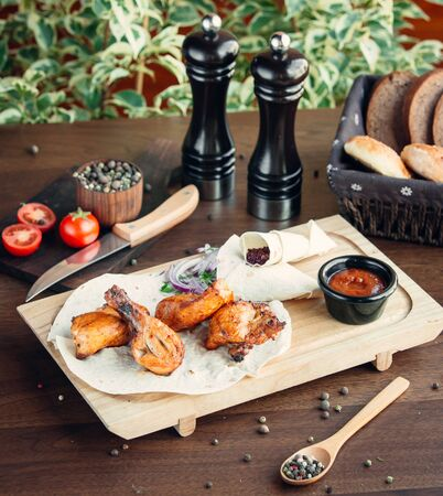 chicken kebab with lavash on wooden board