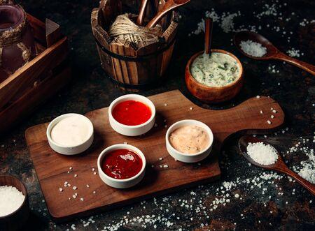 various sauces on wooden board Stockfoto