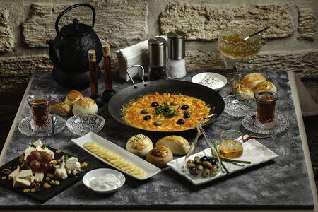 traditional azerbaijani breakfast with egg and tomato dish, tea, cheese