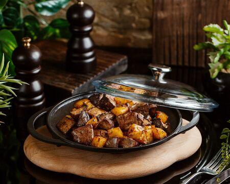 cast iron pan of azerbaijani djiz-biz lamb spleen with