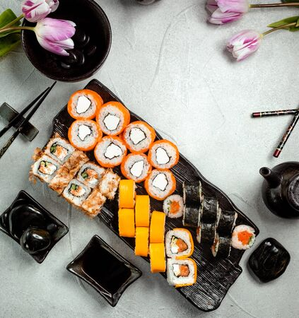 top view of sushi rolls set served with soy sauce