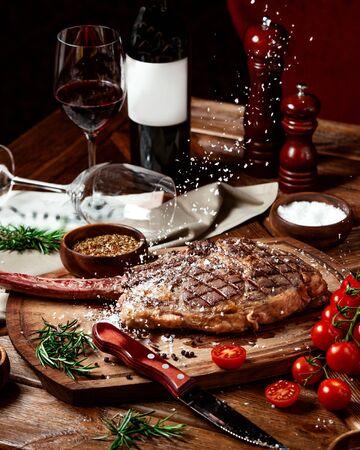 salt sprinkles are fallen on top of beef steak served