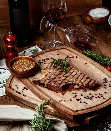 beef stek piece garnished with dried herbs and black pepper Stok Fotoğraf