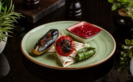 grilled vegetables plate with aubergine, pepper, tomato with pomegranate and Stok Fotoğraf