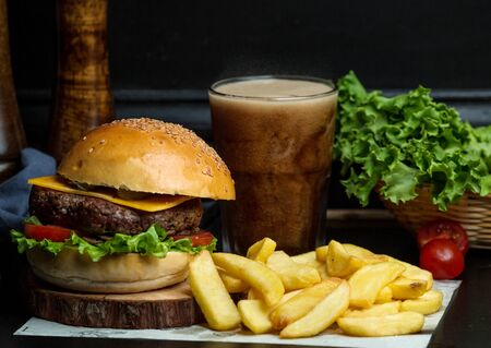 beef burger with cheese, lettuce, tomato served with fries and