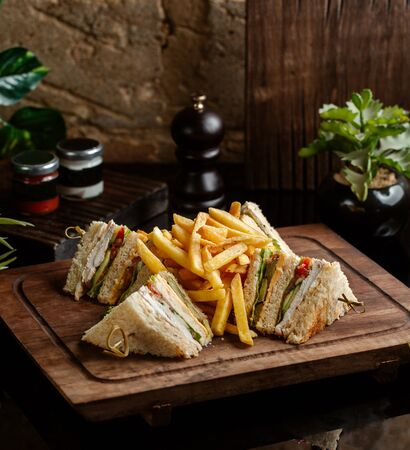 club sandwich with chicken, cucumber, lettuce, tomato, served with fries Stok Fotoğraf