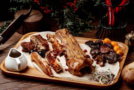 kebab platter with lamb, beef, chicken, lamb spleen, narsharab, fresh